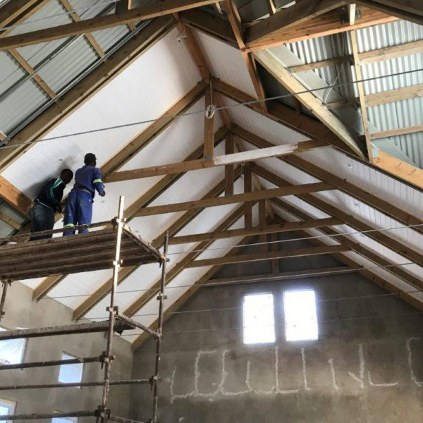 Polystyrene Installation in between Trusses | Thermaboards