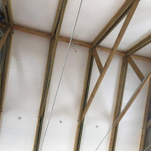 Polystyrene Installation over Exposed Trusses | Thermaboards